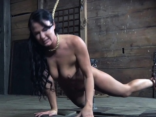 Smalltitted slave struggling while restrained