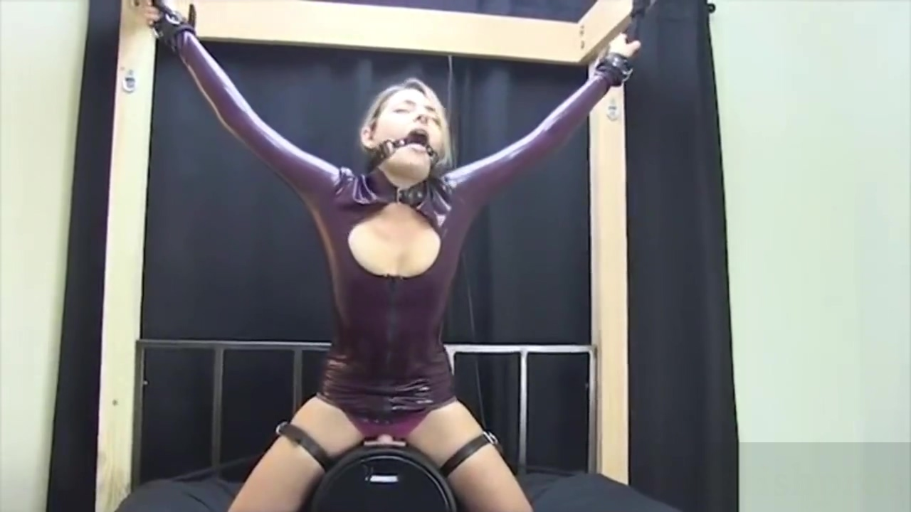 Blond in latex Jacket on Sybian