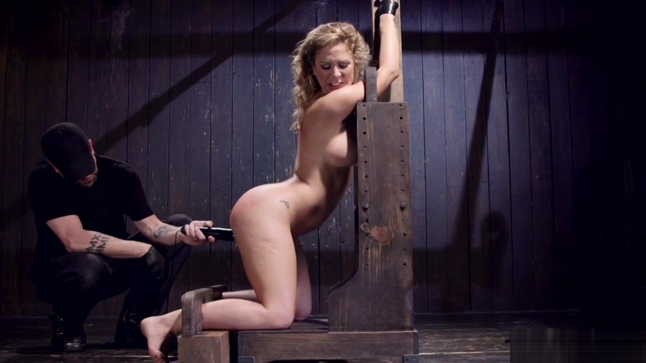 Busty MILF shackled in inverted bondage