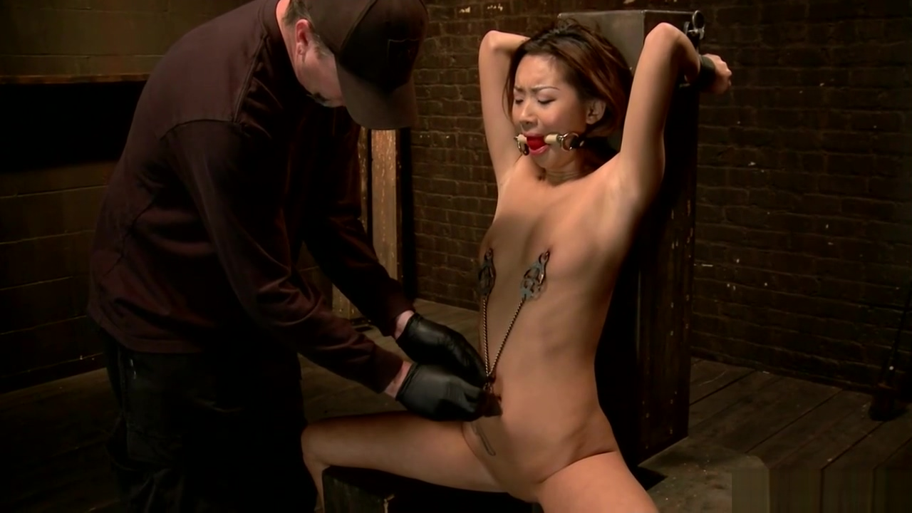 Strapped brunette slave gets fingered