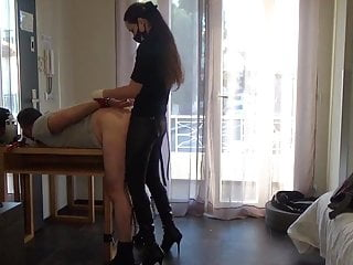Mistress Andrea Parker sodomizes an exhibitionist