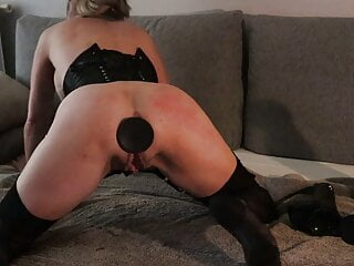 Caly wears a mask, has a plug in her ass and is flogged.