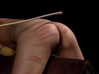 Kinky bitches enjoying BDSM caning and spanking